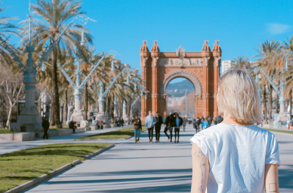 Girl looking at Arc de Triomf in Barcelona