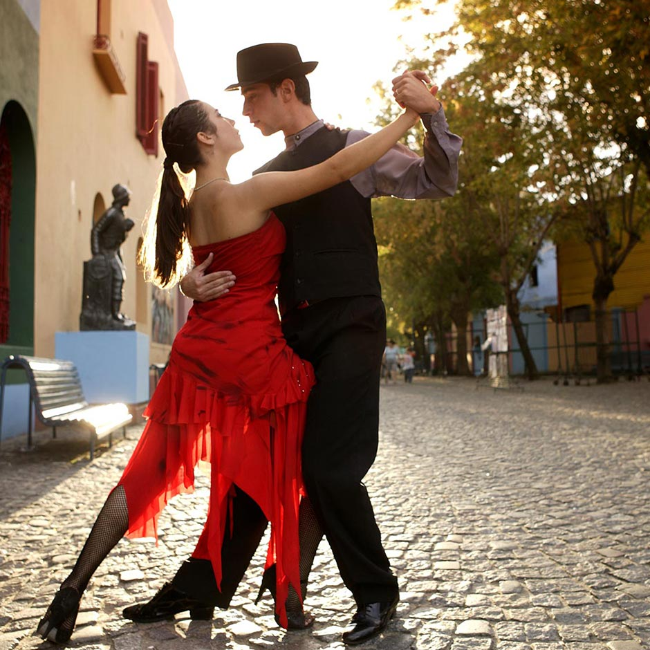 A couple dance the tango on cobbled streets in Buenos Aires