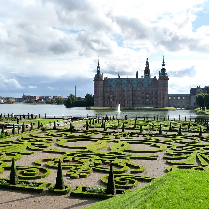 Frederiksborg Castle with lake and Baroque garden in the foreground
